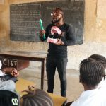 The Water Project: Lungi, Kasongha, DEC Kasongha Primary School -  Teacher Shows Toothbrushing