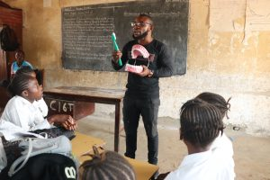The Water Project:  Teacher Shows Toothbrushing