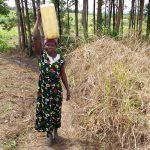 The Water Project: Rubona Kyawendera Community -  Carrying Water On Head