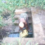 The Water Project: Rubona Kyawendera Community -  Filling Up Container At The Spring