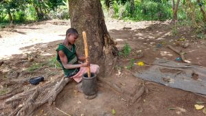 The Water Project:  Girl Pounding Grain