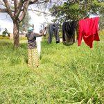 The Water Project: Rubona Kyawendera Community -  Hanging Clothes
