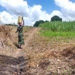 The Water Project: Rubona Kyawendera Community -  Taking Water Home