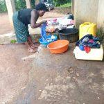 The Water Project: Rubona Kyawendera Community -  Washing Clothes