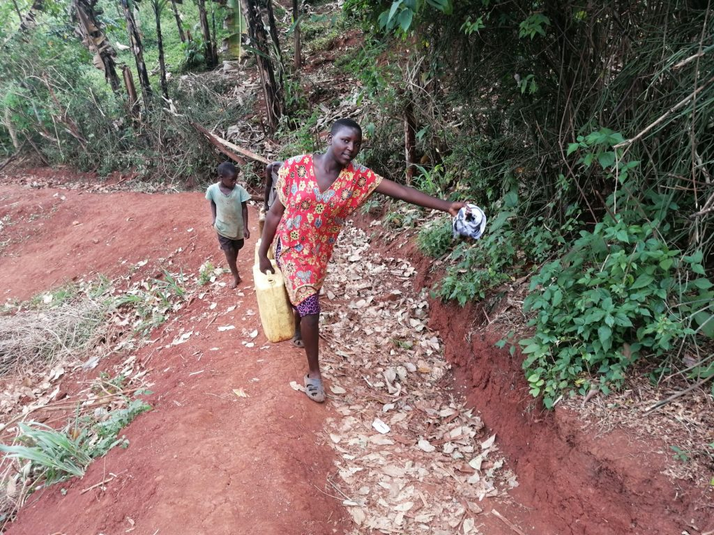 The Water Project : uganda20506-carrying-water-home