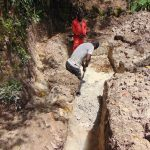 The Water Project: Bukhaywa Community, Ashikhanga Spring -  Digging The Drainage Channel