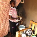 The Water Project: Harambee Community, Elijah Kwalanda Spring -  Nillah Imbusi In Her House Showing Water Storage