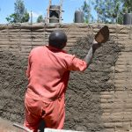 The Water Project: Gamalenga Primary School -  Cementing Outer Tank Wall
