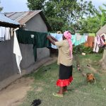 The Water Project: Mukhonje Community, Mausi Spring -  Taking Down Dry Clothes