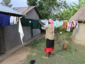 The Water Project:  Taking Down Dry Clothes