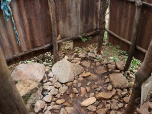 The Water Project:  Bathing Shelter Rocky Floor
