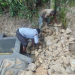 The Water Project: Bukhaywa Community, Ashikhanga Spring -  Backfilling With Stones