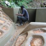 The Water Project: Chepnonochi Community, Shikati Spring -  Plastering