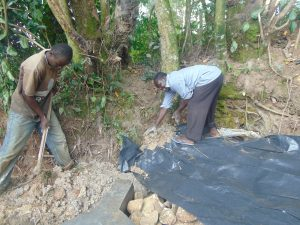 The Water Project:  Adding The Plastic Tarp
