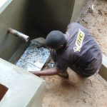 The Water Project: Chepnonochi Community, Shikati Spring -  Tile Setting