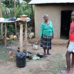 The Water Project: Mukhonje Community, Mausi Spring -  Outside The Kitchen Next To A Dish Rack