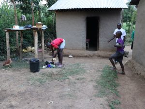 The Water Project:  A Boy Washing Utensils