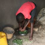 The Water Project: Mukhonje Community, Mausi Spring -  A Girl Preparing Vegetables