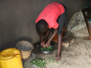 The Water Project:  A Girl Preparing Vegetables