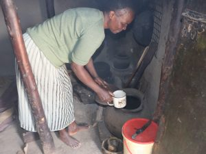 The Water Project:  Grace Drawing Water From Storage Pot