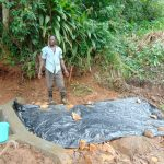 The Water Project: Chepnonochi Community, Shikati Spring -  Laying The Tarp