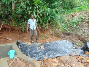 The Water Project:  Laying The Tarp