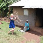 The Water Project: Mahira Community, Wora Spring -  A Girl Collecting Firewood