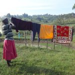 The Water Project: Mahira Community, Kusimba Spring -  Hanging Clothes To Dry
