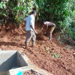 The Water Project: Chepnonochi Community, Shikati Spring -  Soil Backfilling