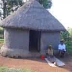 The Water Project: Mahira Community, Jairus Mwera Spring -  People Outside A Traditional Hut
