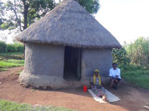 The Water Project:  People Outside A Traditional Hut