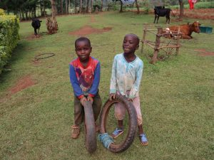 The Water Project:  Children Playing With Used Tires