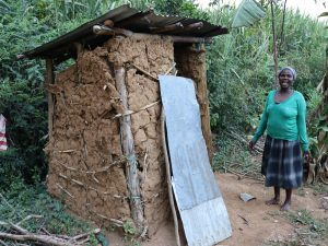 The Water Project:  Grace Stands With Her Pit Latrine