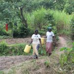 The Water Project: Litinye Community, Shivina Spring -  Women Walking To Fetch Water