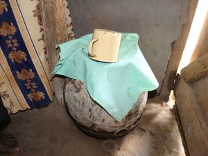 The Water Project:  Water Storage Container Covered With Cloth And Cup