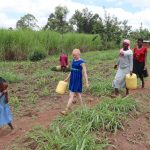 The Water Project: Mahira Community, Wora Spring -  Community Members Going To Collect Water