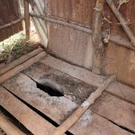 The Water Project: Harambee Community, Elijah Kwalanda Spring -  Wooden Latrine Floor Scattered With Ash