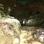The Water Project: Mahira Community, Wora Spring -  Wora Spring Sandwiched Between Rocks