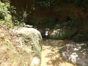 The Water Project:  Wora Spring Sandwiched Between Rocks
