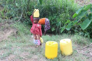 The Water Project:  Baby Joy Carrying Her Own Water From The Spring