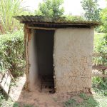 The Water Project: Mukhuyu Community, Chisombe Spring -  Pit Latrine Made Of Mud Walls