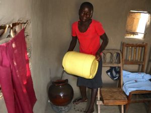 The Water Project:  Filling Water Storage Pot