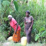 The Water Project: Litinye Community, Shivina Spring -  In Line To Collect Water