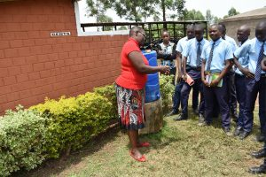 The Water Project:  Trainer Jacky Shows Correct Handwashing Steps
