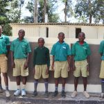 The Water Project: Friends School Mahira Primary -  Gents Posing Outside Their New Latrines