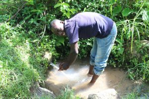 The Water Project:  Mark Washing Hands At The Spring