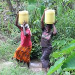The Water Project: Litinye Community, Shivina Spring -  Women Carrying Water From The Spring