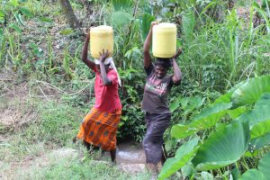 The Water Project:  Women Carrying Water From The Spring