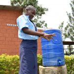 The Water Project: St. Peter's Khaunga Secondary School -  Pupil Demonstrates Handwashing
