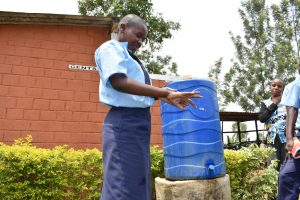 The Water Project:  Pupil Demonstrates Handwashing